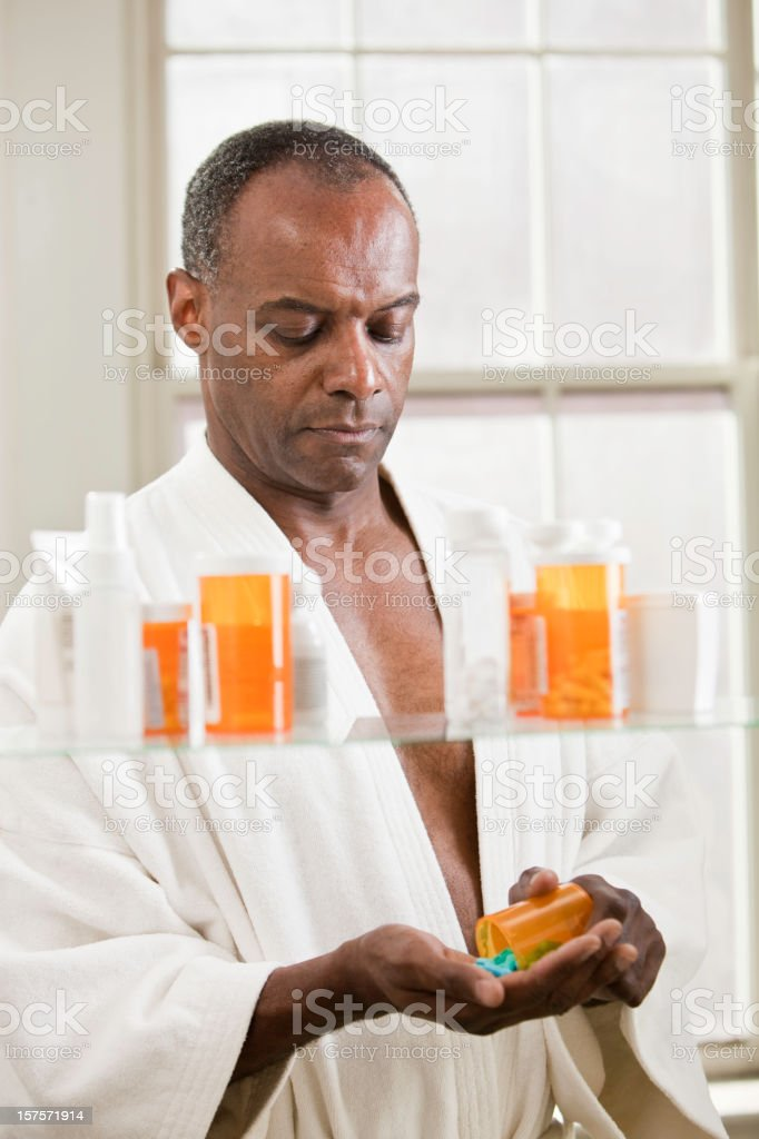 Serious Man with Prescription Drugs royalty-free stock photo