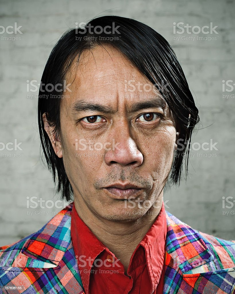 Serious man with weird suit stock photo
