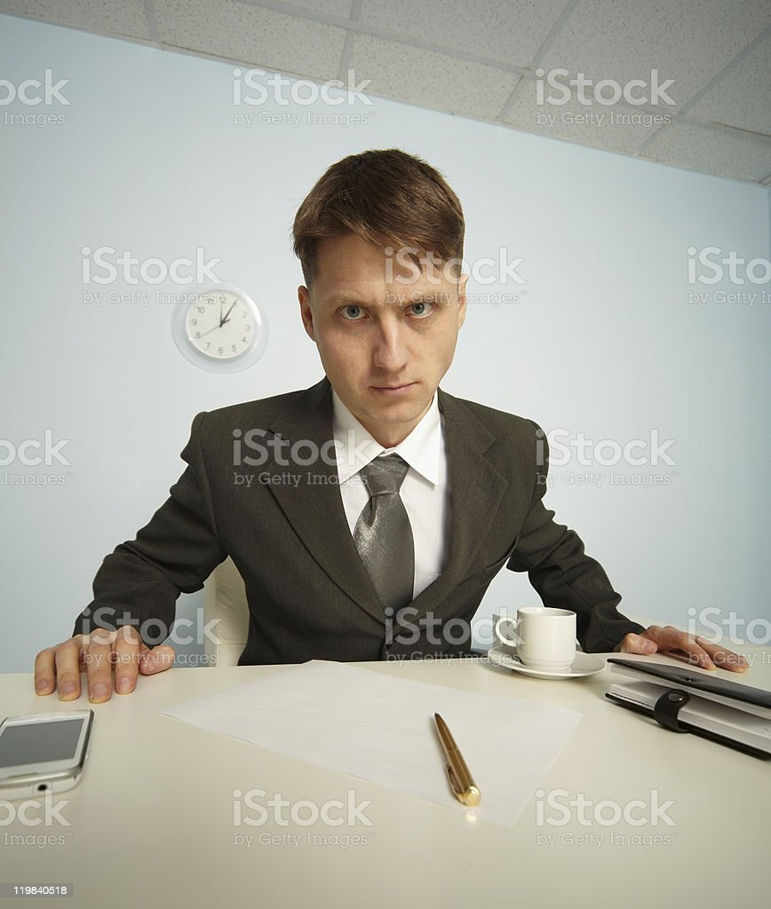 Serious manager strictly looking at you stock photo