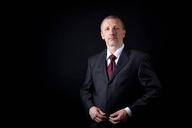 Serious mature businessman stock photo