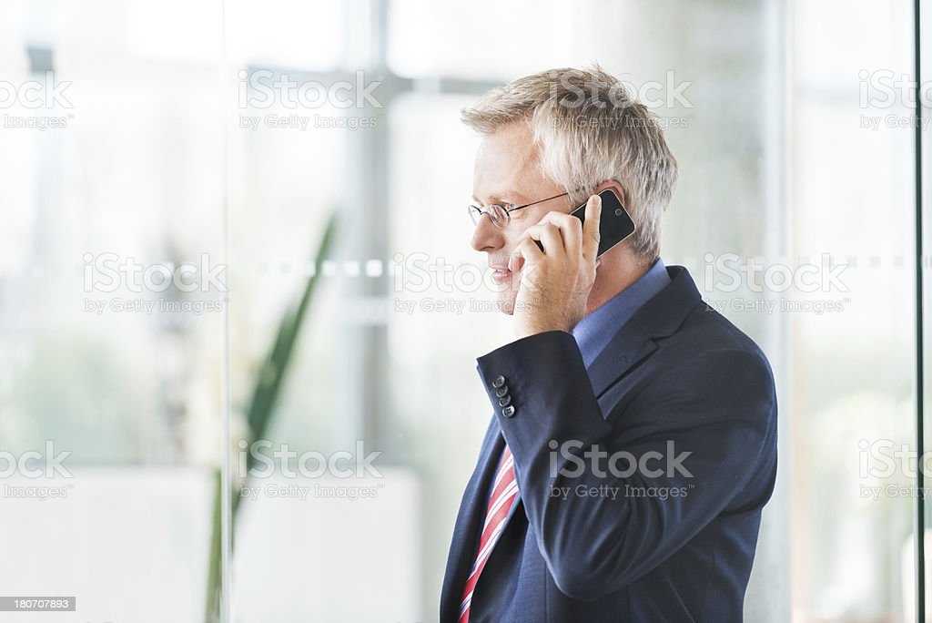 Serious Mature Businessman With Smart Phone royalty-free stock photo
