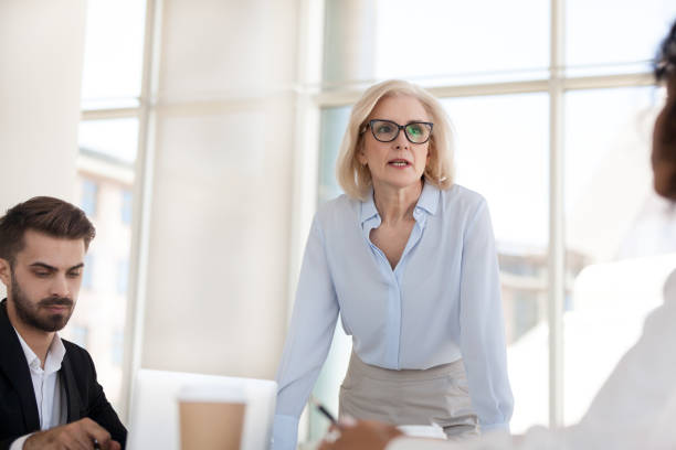 serious mature businesswoman talk having discussion during briefing - midsection stock pictures, royalty-free photos & images