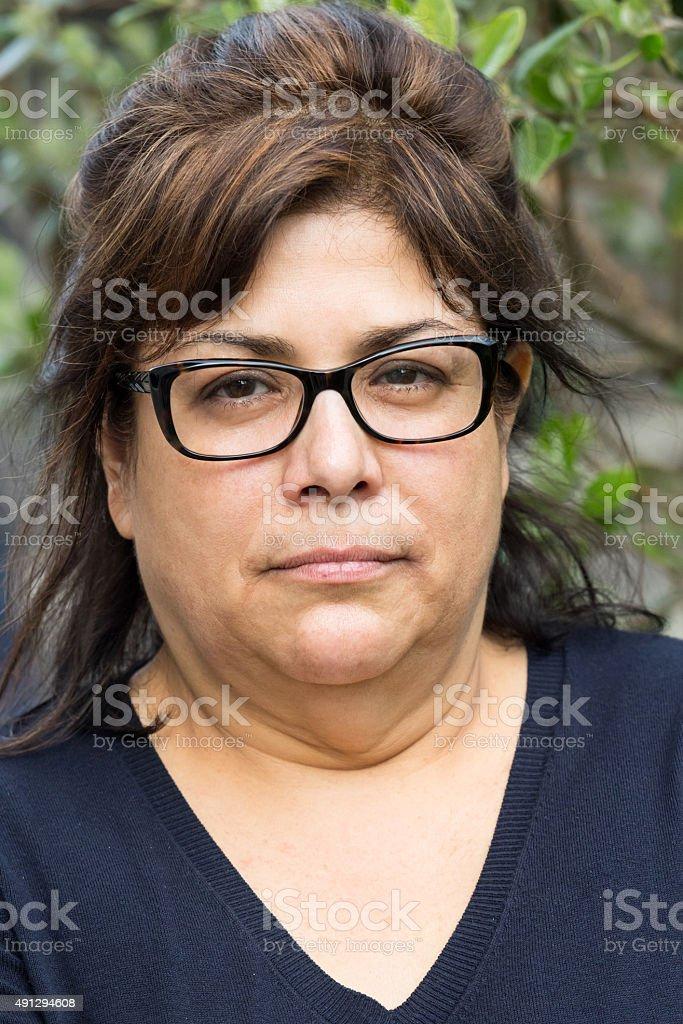 serious mature hispanic woman stock photo