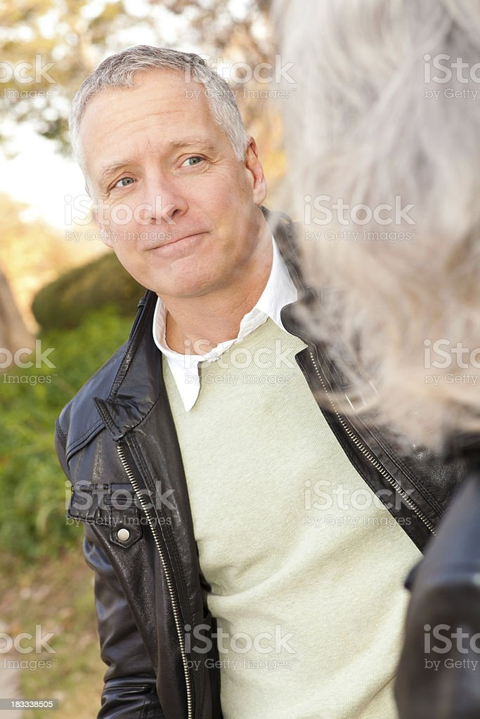 Serious Mature Man Listening to Partner Outdoors royalty-free stock photo