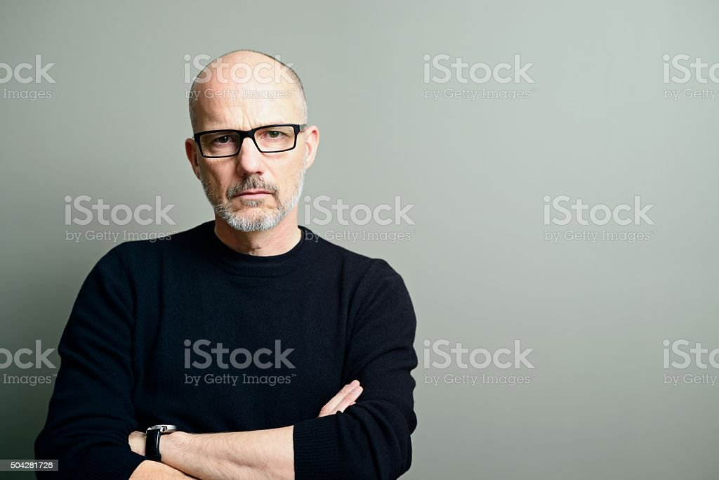 Serious Mature Man Looking at Camera stock photo