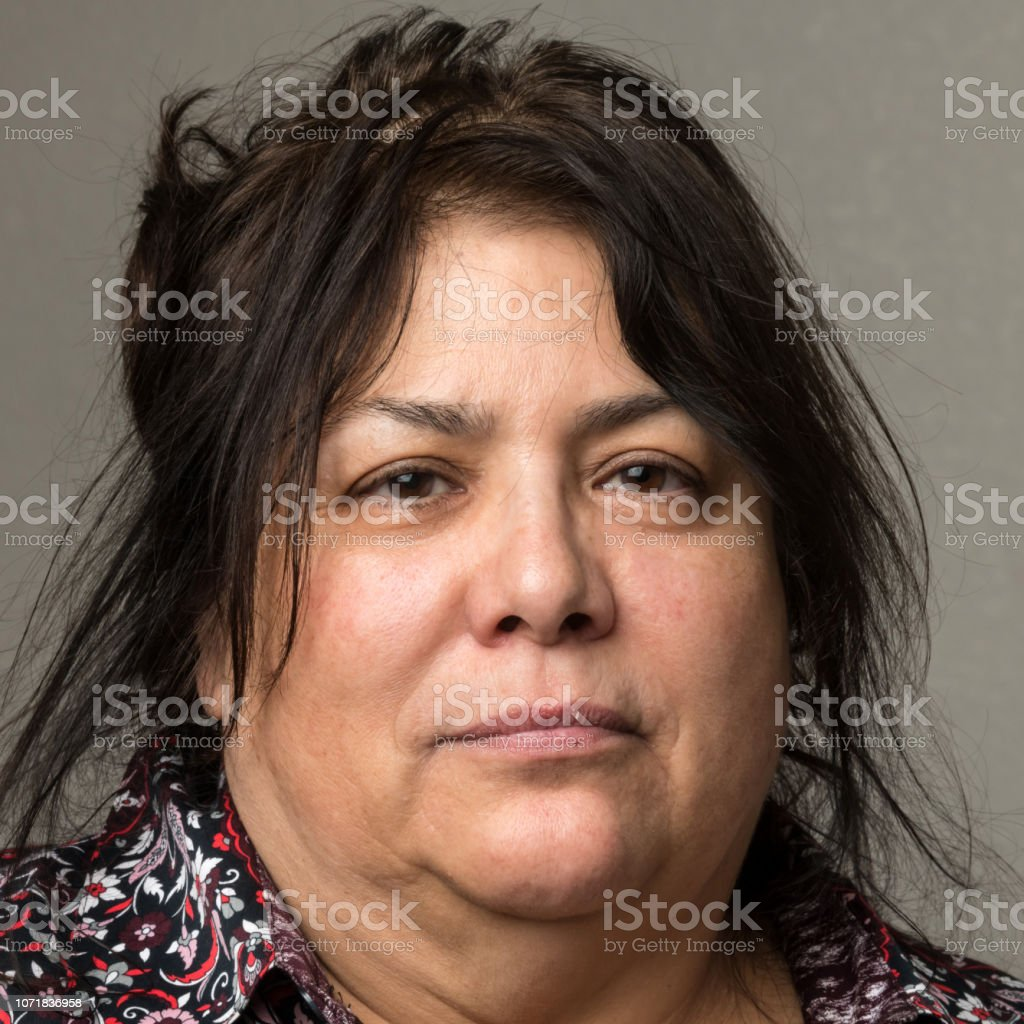 Serious mature/senior woman looking at the camera stock photo