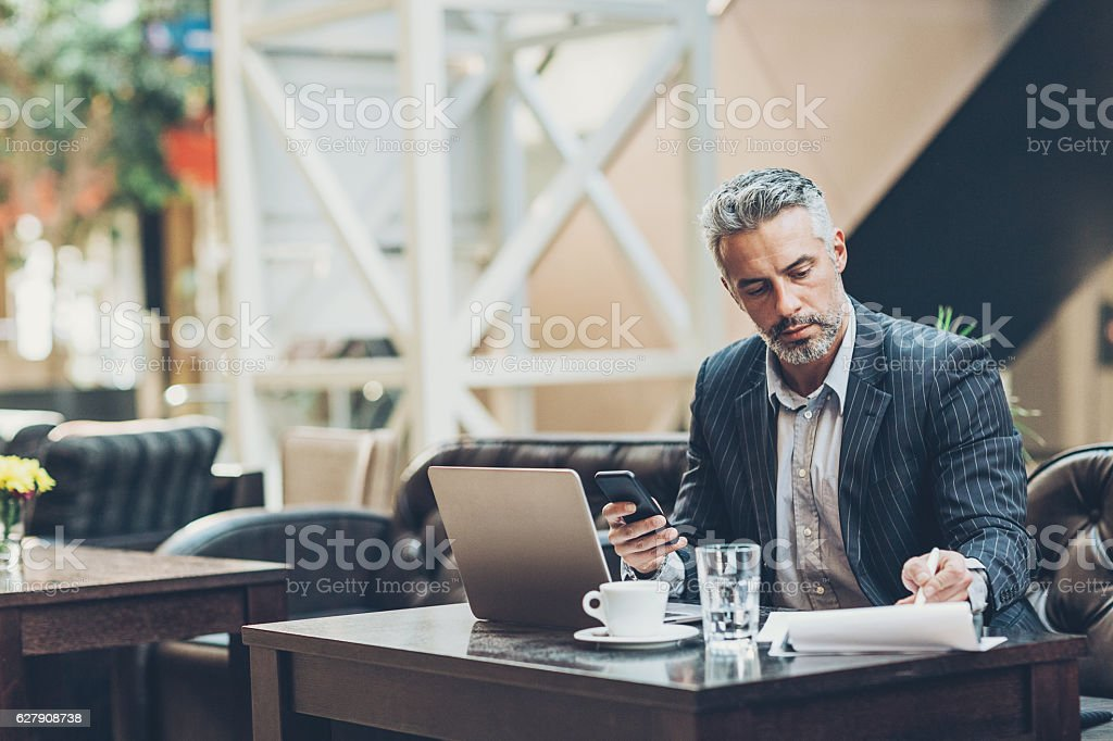 Serious middle age businessman stock photo