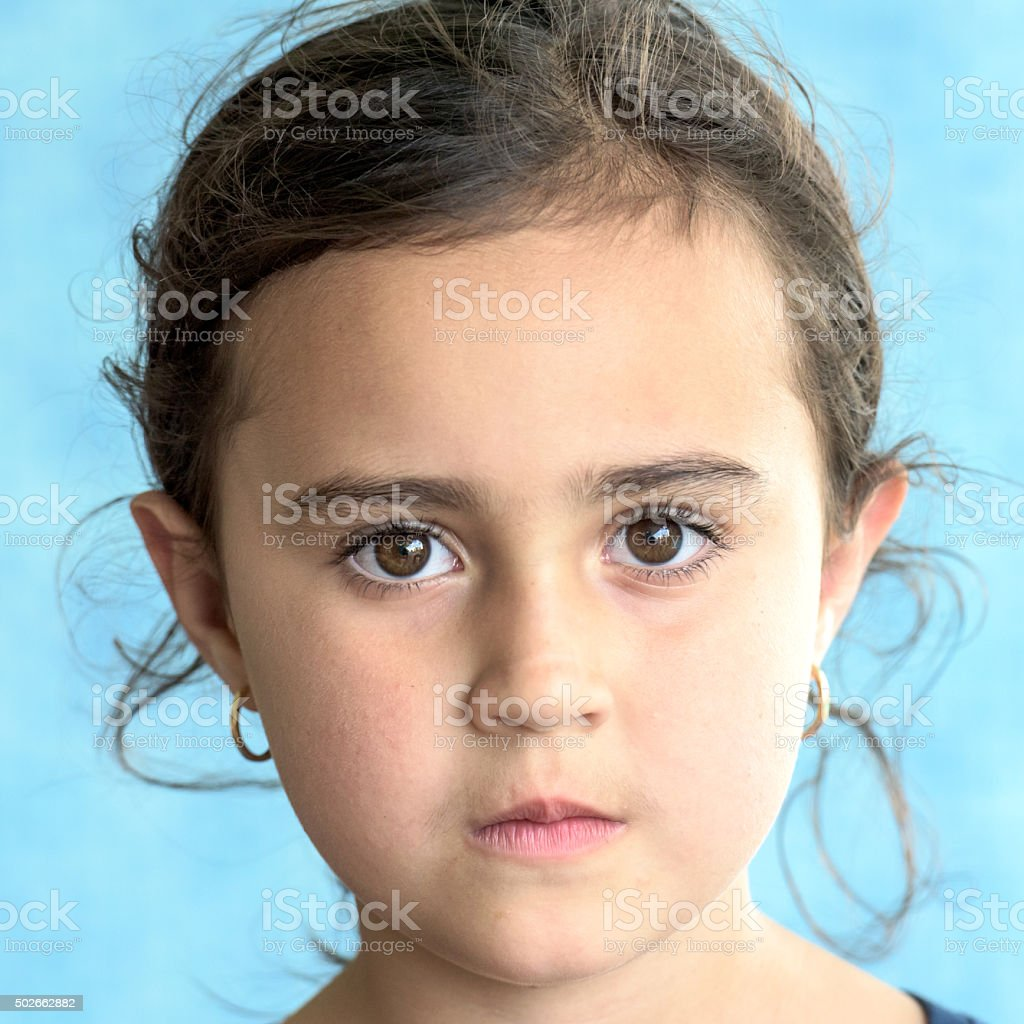 Serious middle eastern little girl stock photo