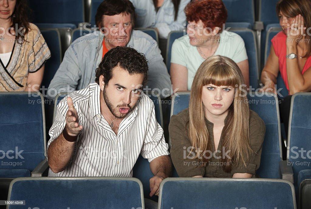 Serious Moviegoers stock photo