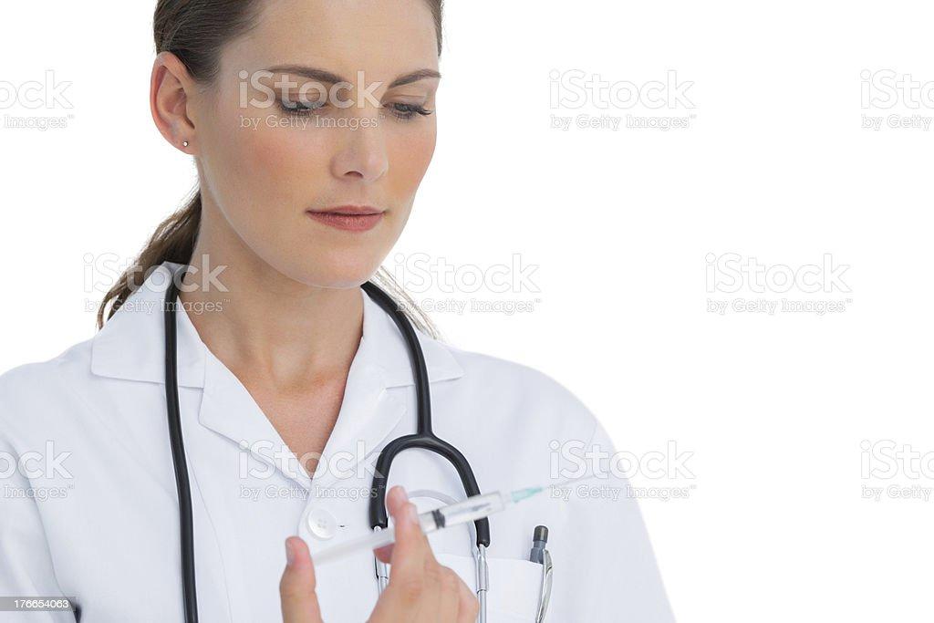 Serious nurse holding a syringe royalty-free stock photo