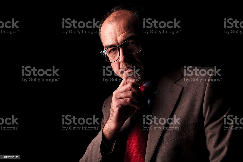 serious old business man thinking stock photo