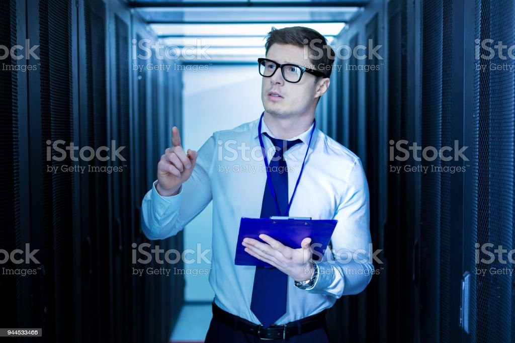 Serious operator pointing a finger stock photo