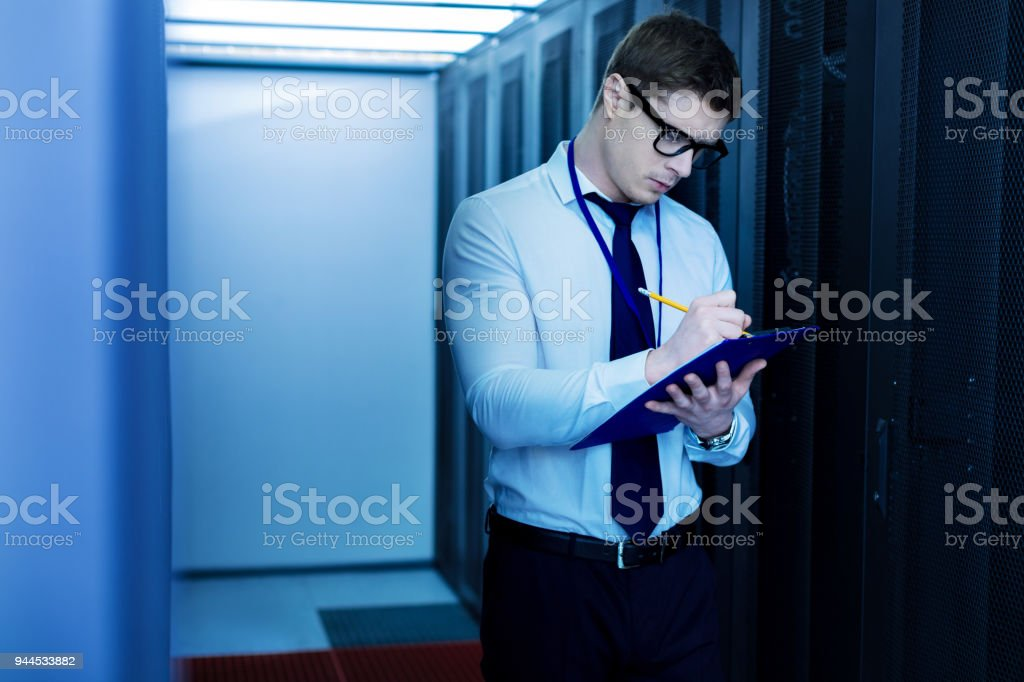 Serious operator taking important notes stock photo