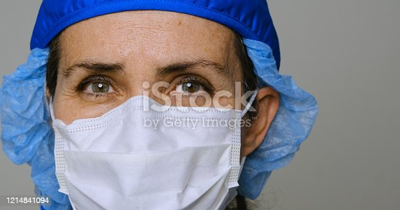 Mature serious overworked, female mature health care worker