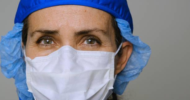 serious, overworked, female health care worker - infermiera personale medico foto e immagini stock