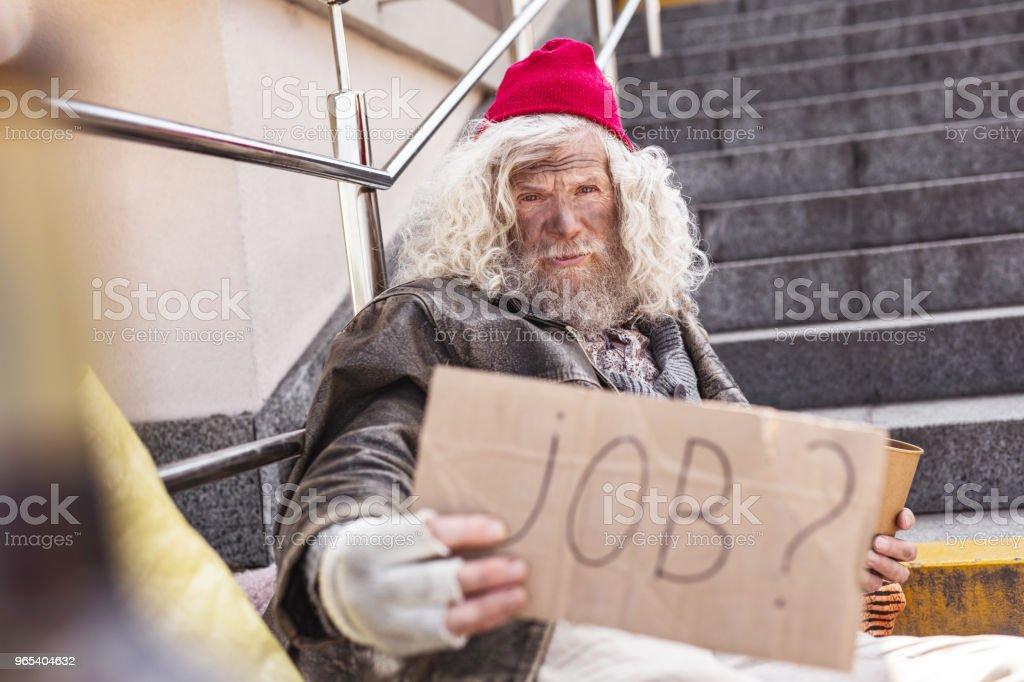 Serious poor man needing a job zbiór zdjęć royalty-free