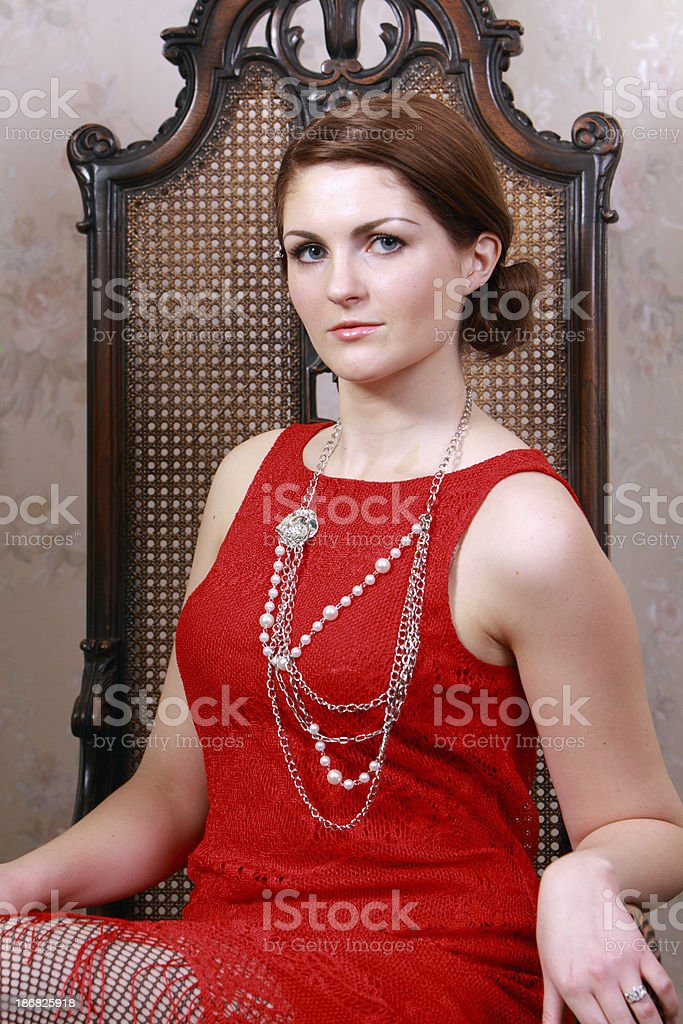 Serious portrait of woman in 1920's outfit royalty-free stock photo