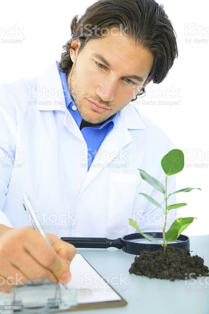Serious Scientist Writing Research Report royalty-free stock photo