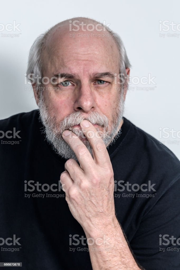 Serious Senior Adult Man Listening Headshot stock photo