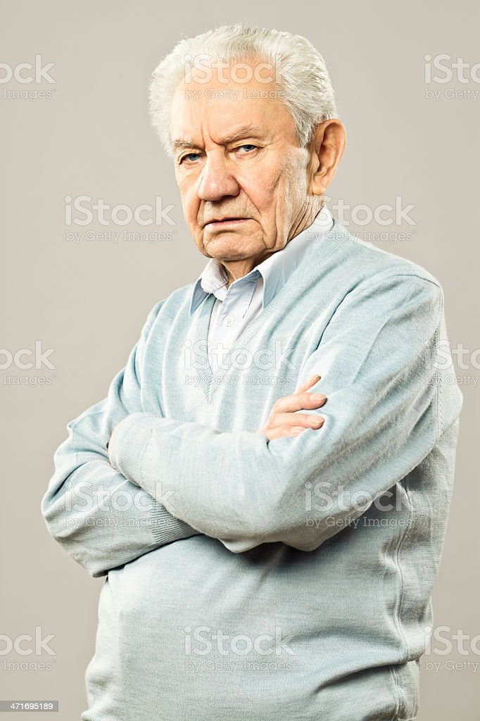 Serious senior man looking at camera stock photo