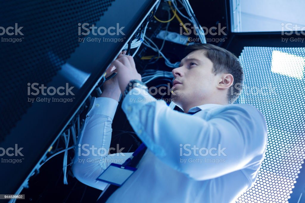 Serious skillful operator repairing wires stock photo