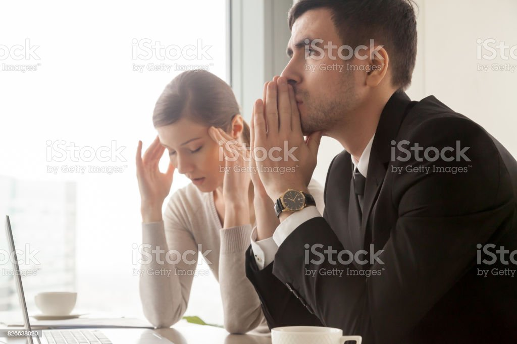 Serious stressed businessman businesswoman worried about business problems, company bankruptcy stock photo