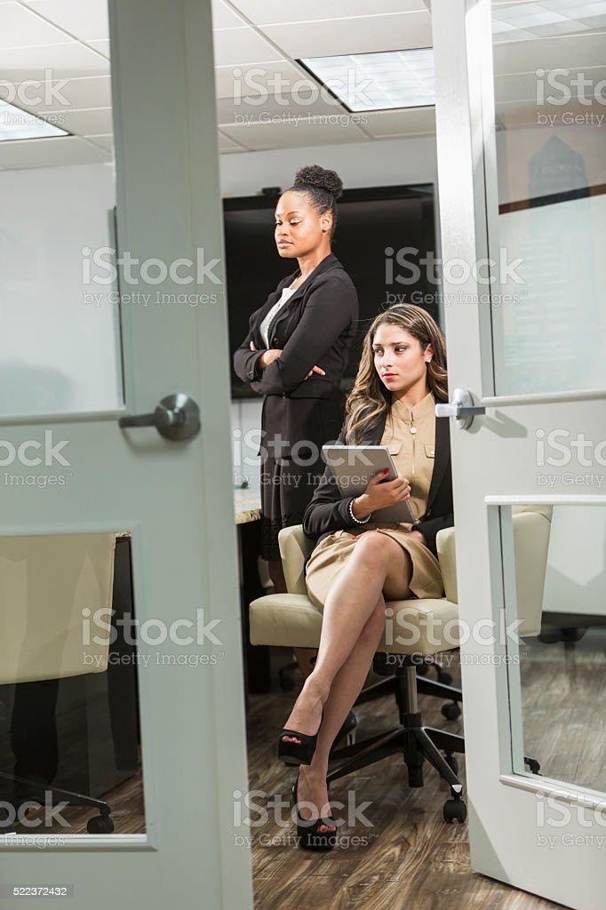 Serious, successful, young multi-ethnic businesswomen stock photo
