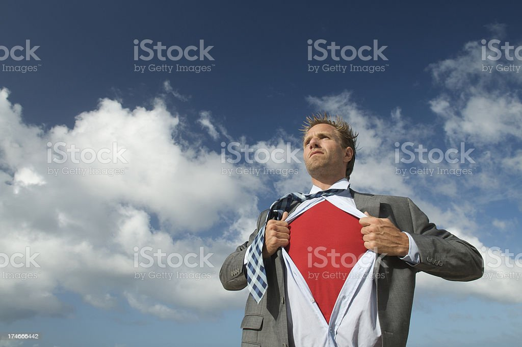 Serious Superhero Businessman Revealing Red Chest Outdoors Sky Background royalty-free stock photo