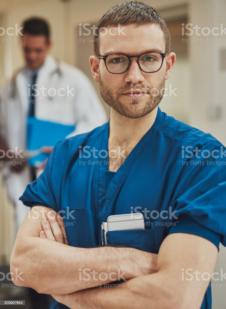 Serious surgeon looking intently at the camera stock photo