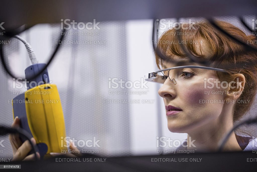 Serious technician working on a server stock photo
