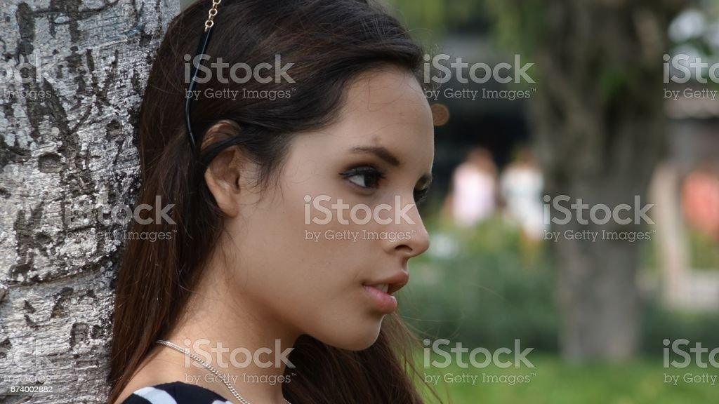 Serious Teen Girl In Park royalty-free stock photo