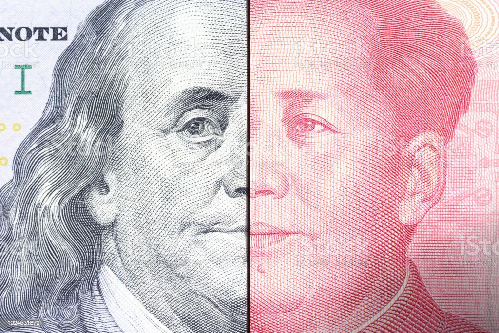 Serious trade tension or trade war between US and China, financial concept : Notes of USA and China with faces of Benjamin Franklin and Mao Zedong, depicts trade deficit between Washington and Beijing stock photo