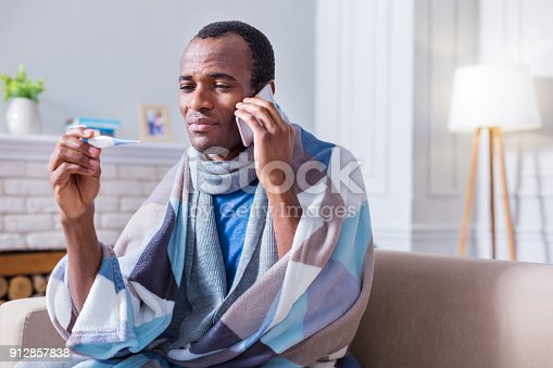 istock Serious unhappy man calling to the hospital 912857838