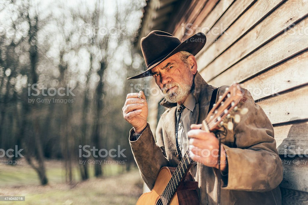 Serious Western Guitarist Staring at the Camera stock photo