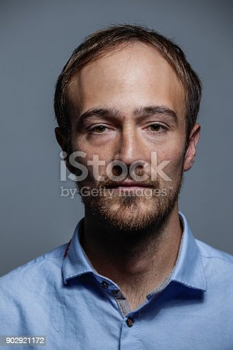 612752180istockphoto Serious White man Portrait 902921172