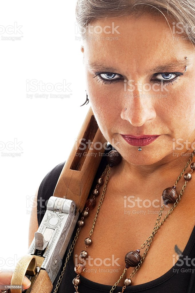 Serious Woman holding a riffle royalty-free stock photo