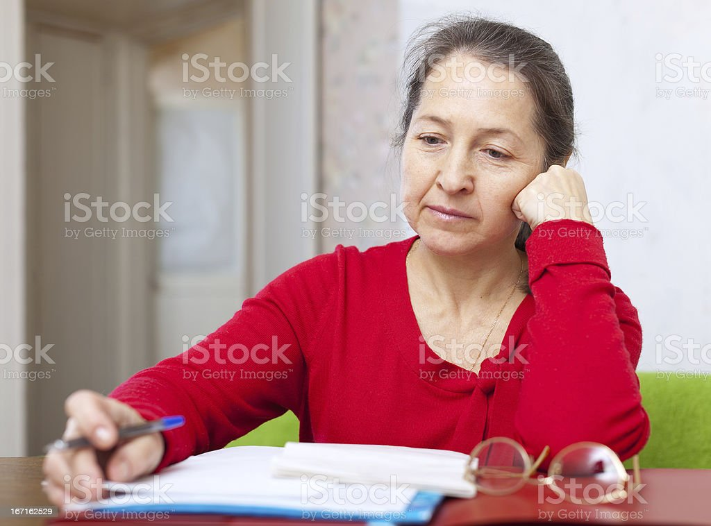 serious  woman reads documents royalty-free stock photo