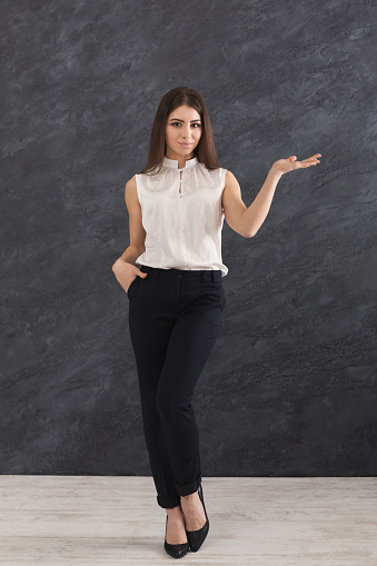 istock Serious woman showing something, holding hand 962207008