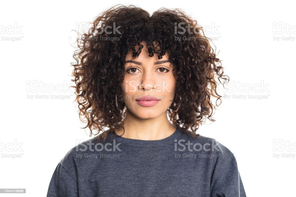 Serious woman with curly hair stock photo