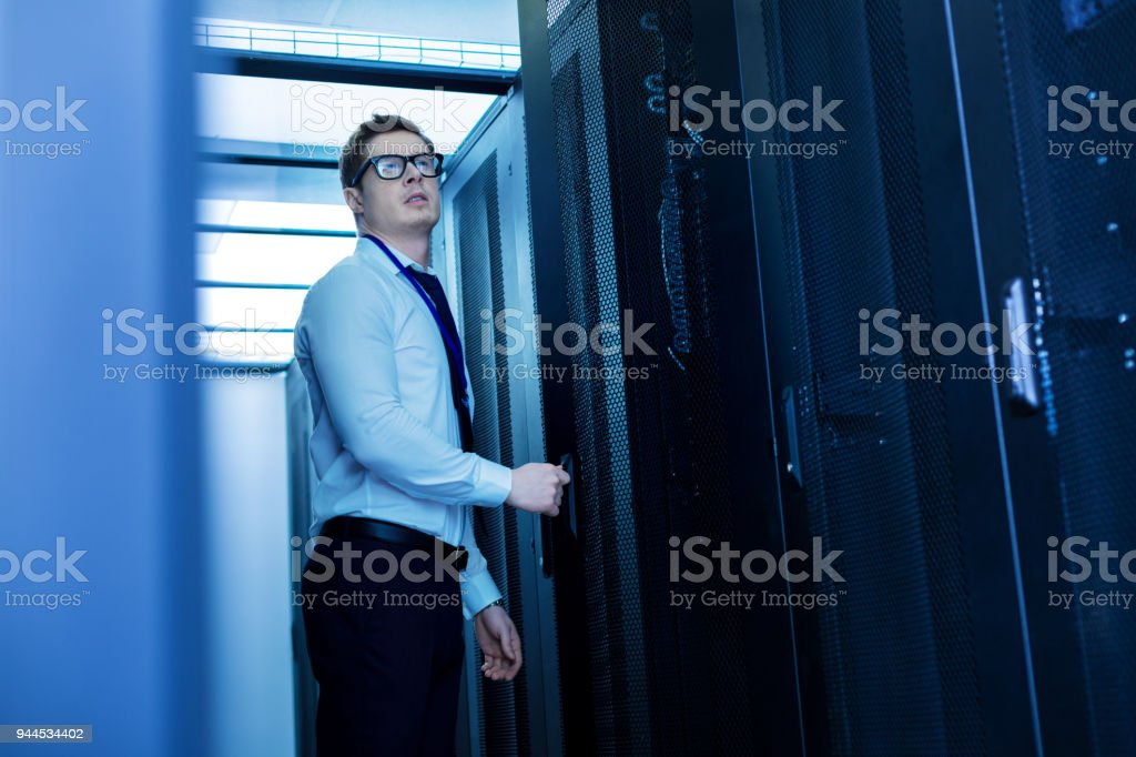 Serious worker standing in the office stock photo
