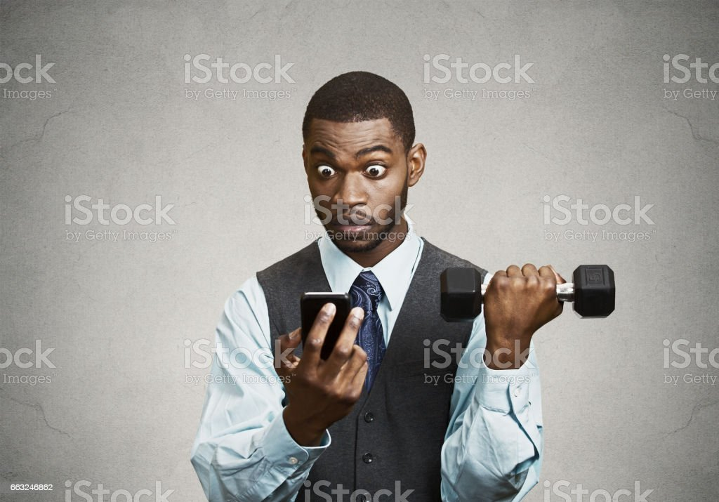 serious worried business man reading bad news on smart phone holding mobile, lifting weight stock photo