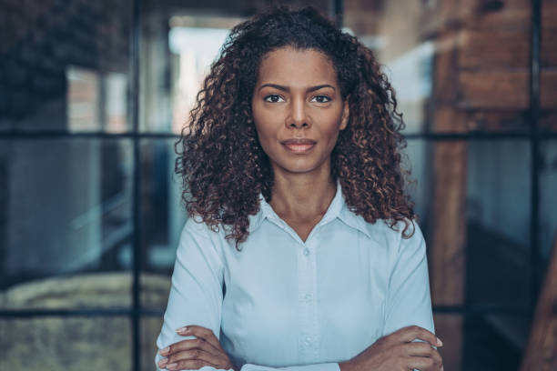 Serious young African-American businesswoman Portrait of a businesswoman looking at camera civil rights stock pictures, royalty-free photos & images