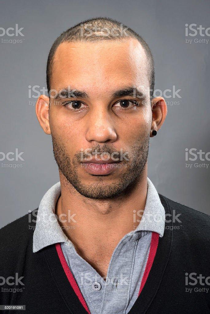 Serious young afrocaribbean man stock photo