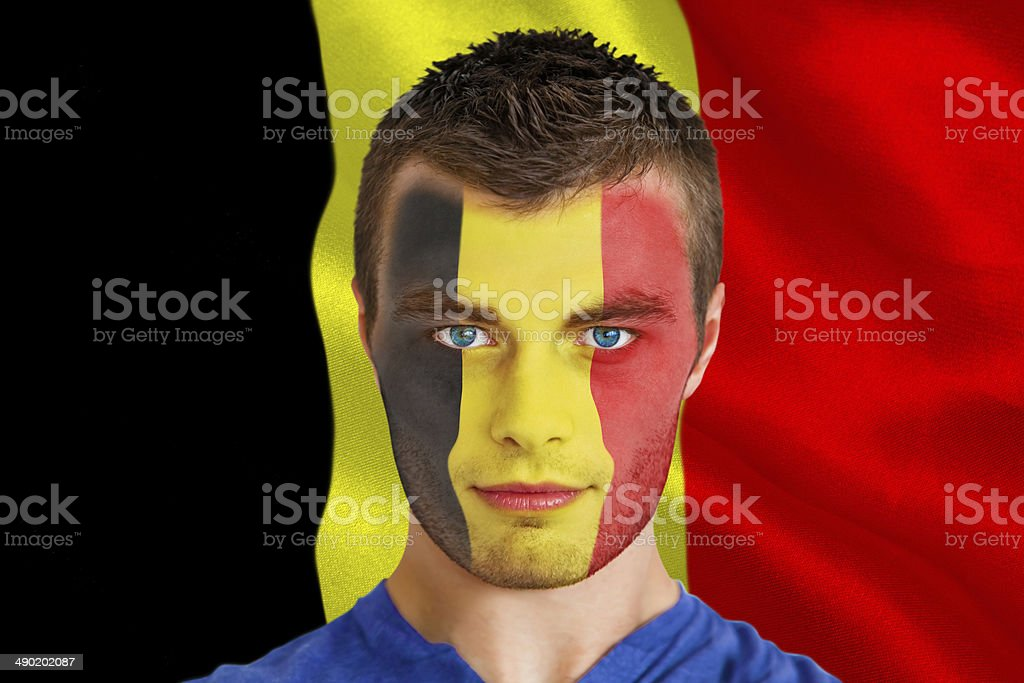 Serious young belgium fan with facepaint stock photo