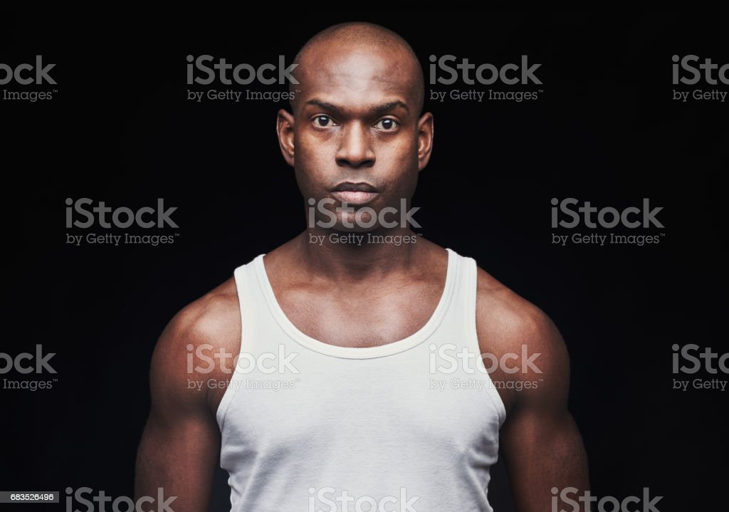 Serious young black man in undershirt stock photo