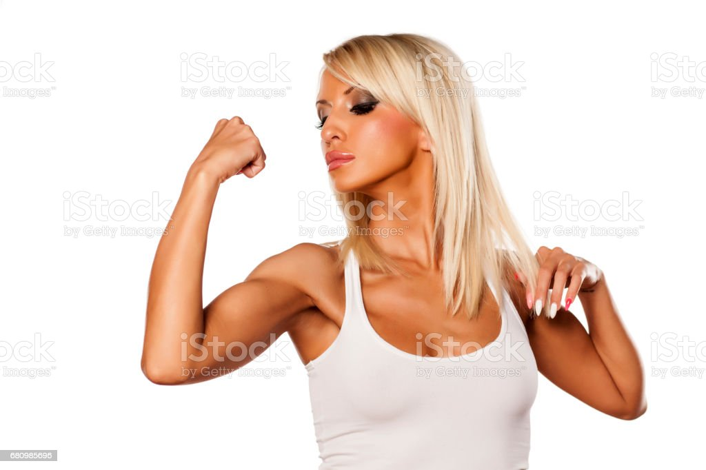 serious young blonde showing her biceps royalty-free stock photo