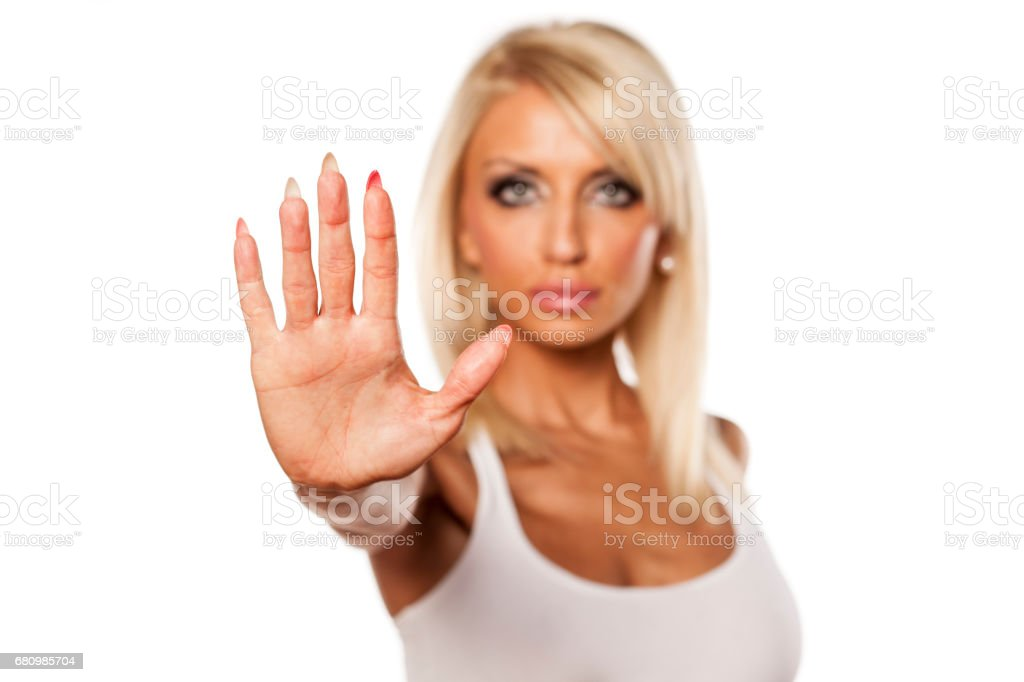 serious young blonde showing stop hand royalty-free stock photo
