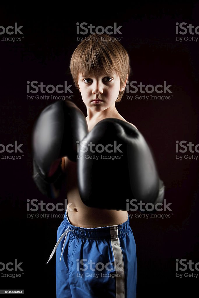 serious young boxer Boy on Black background stock photo