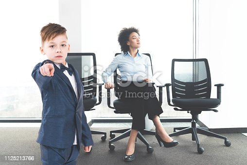 istock Serious young business boy 1125213766
