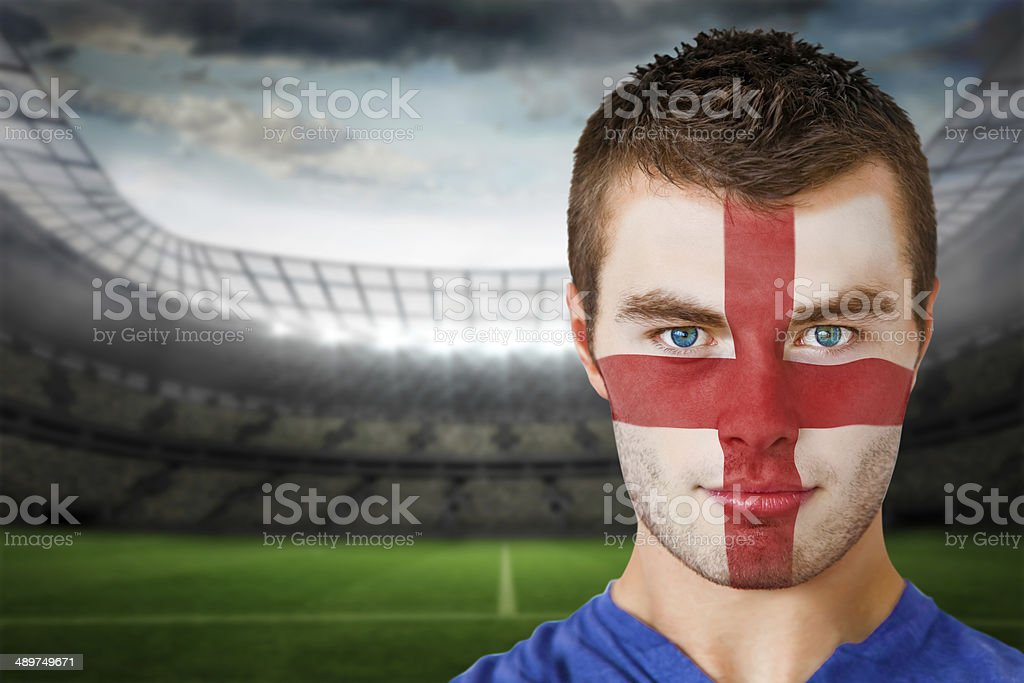 Serious young england fan with face paint stock photo